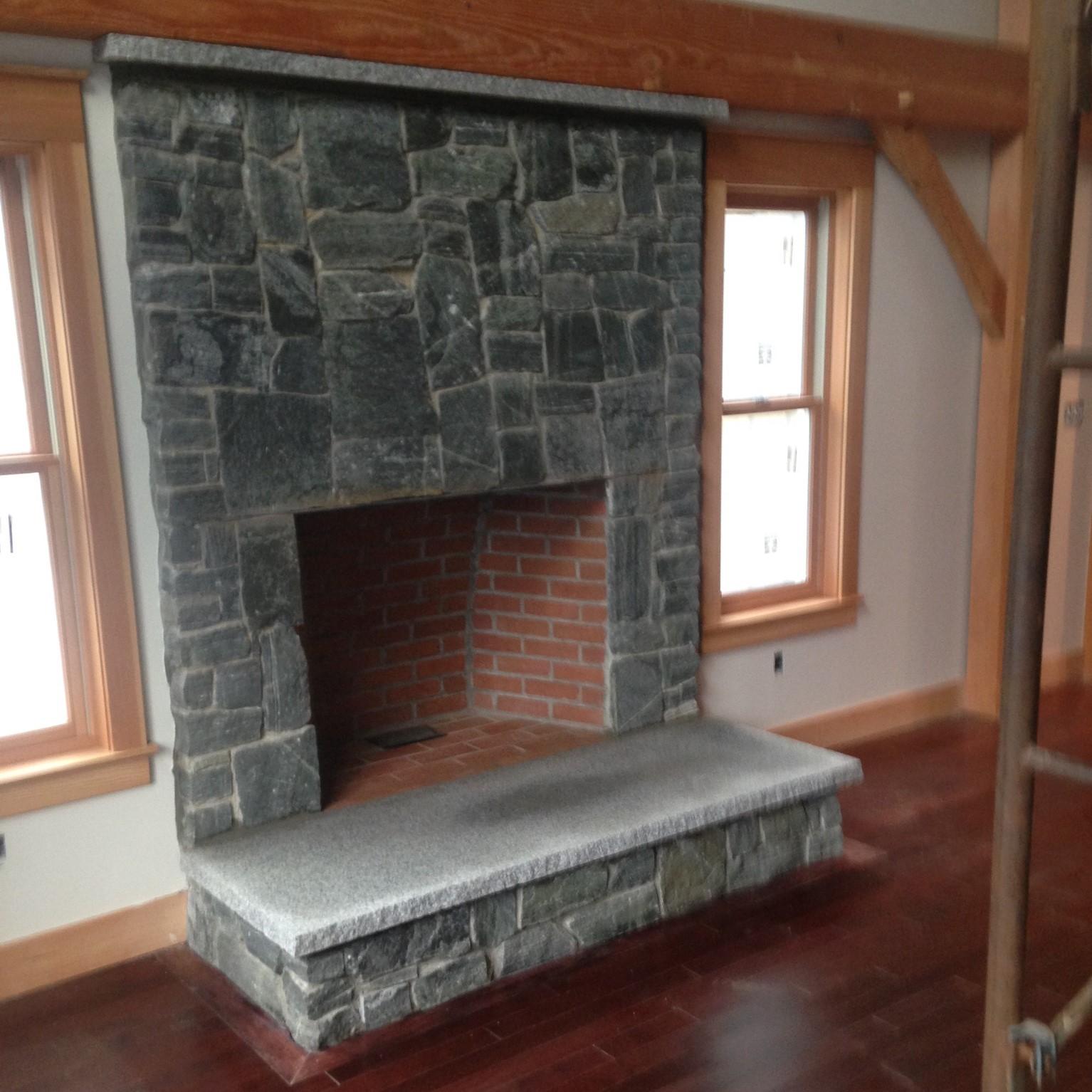 residential masonry constrcution stone veneer fireplace