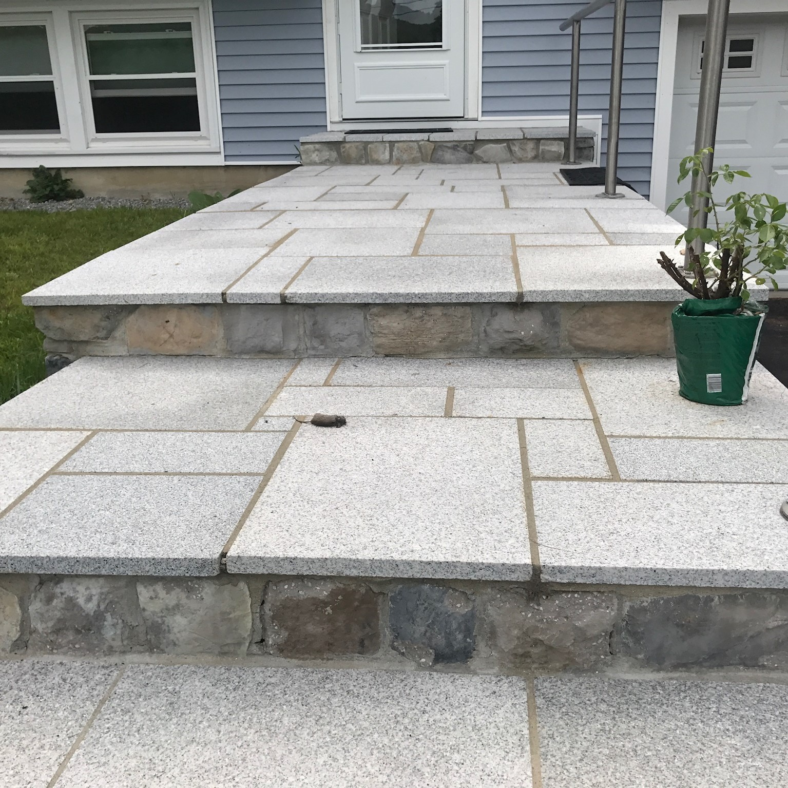 Granite Patio and Steps with Cultured Stone Risers in Bennington New Hampshire