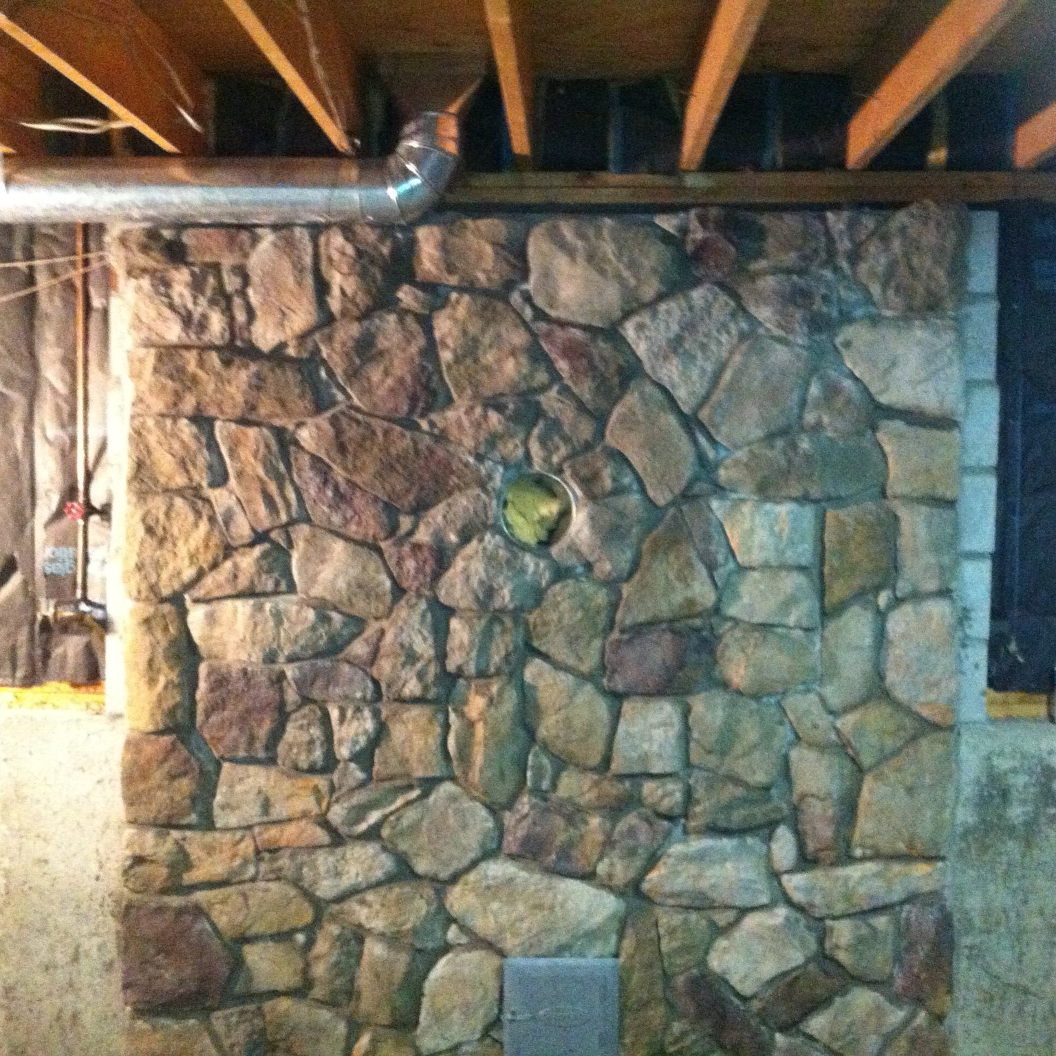 Stone Veneer behind wood stove in Massachusetts